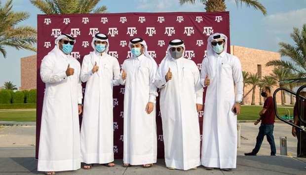 Five Tamuq graduates after receiving their Aggie rings