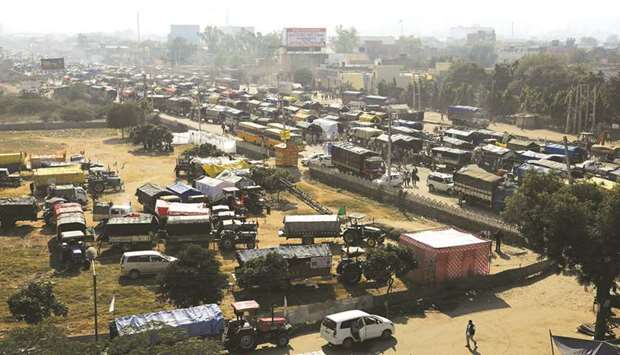 Tractors and trucks are seen parked on a national highway during a protest against the newly passed
