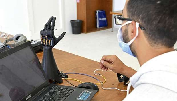 Tunisian engineers test a prototype of an artificial hand at Cure Bionics startup in Sousse.