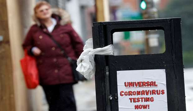 "A poster reading ""Universal Coronavirus Testing Now!"" is seen in Liverpool, Britain"