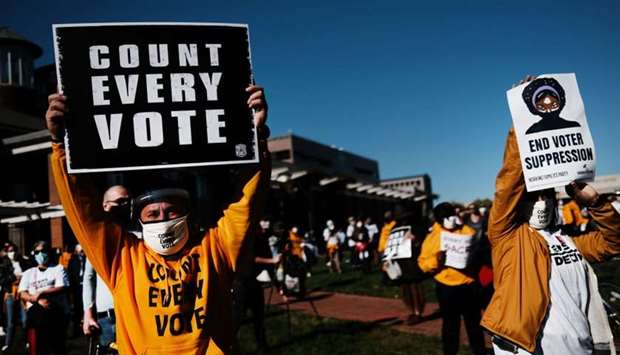 People participate in a protest in support of counting all votes as the election in Pennsylvania is