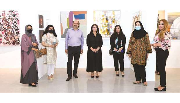 Some artists with curator Dana Saed in the centre