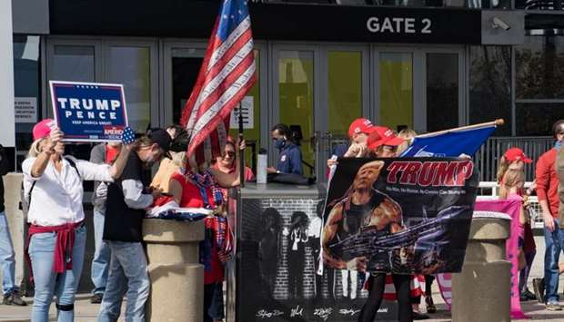 Supporters of President Donald Trump protest outside State Farm Arena as ballots continue to be coun