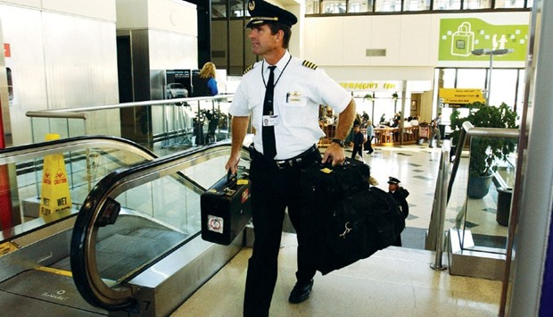 A Delta Airline pilot exits Terminal B at New Jersey's Newark Airport (file). A pilots union at the