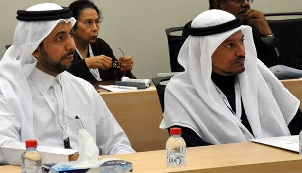 HE the Minister of Labour and Social Affairs Dr Abdullah Saleh Mubarak al-Khulaifi (right) and QU pr