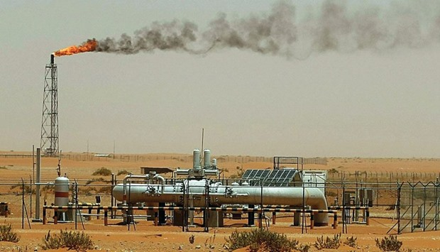"""A picture taken on June 23, 2008 shows a flame from a Saudi Aramco oil installion known as """"Pump 3"""""""