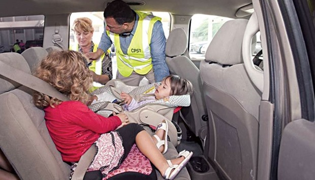 A CPST technician explains the method to install child car seats and for positioning children correc