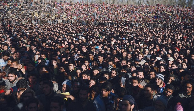 Villagers attend the funeral for suspected rebel Shariq Ahmed Bhat at Bandana village of Pulwama dis