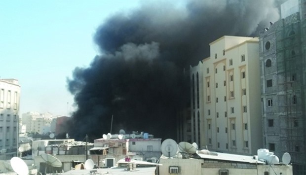 Thick black smoke spewing out of the place where fire broke out in Doha's Najma area
