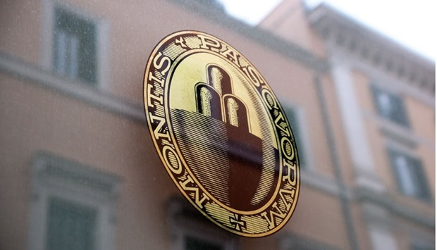 The Banca Monte dei Paschi logo sits on a window at one of the company's branches in Rome on Wednesd