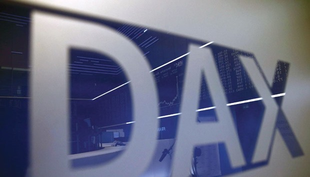 The trading floor of the Frankfurt Stock Exchange is reflected in a DAX sign. European shares fell s