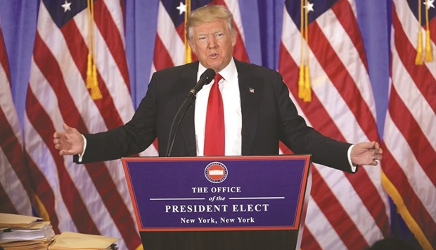 President-elect Donald Trump speaks at a news conference yesterday at Trump Tower in New York City.