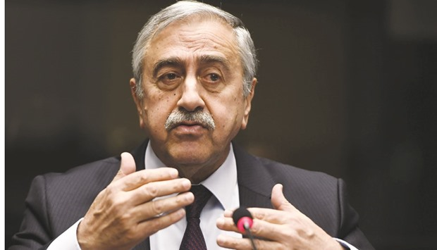 Turkish Cypriot leader Mustafa Akinci gestures as he speaks during a press conference on UN-sponsore