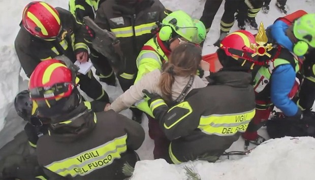 Firefighters rescue a survivor from Hotel Rigopiano in Farindola, central Italy, hit by an avalanche