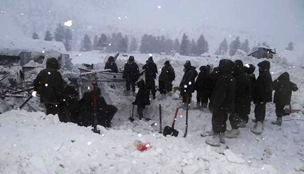 Indian army soldiers are pictured during a rescue operation to find soldiers trapped at the site of