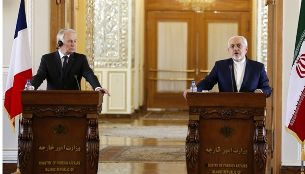 French Foreign Minister Jean-Marc Ayrault (L) and Iranian Foreign Minister Mohammad Javad Zarif