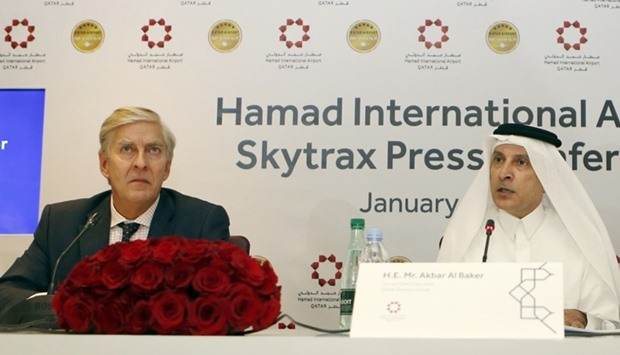 Skytrax CEO Edward Plaisted (L) and Qatar Airways chief executive Akbar al-Baker hold a press confer
