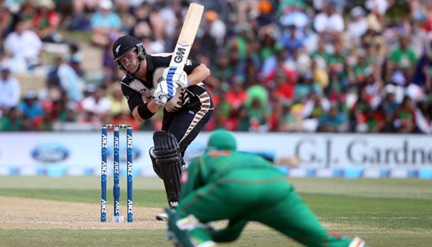 Corey Anderson (C) of New Zealand bats during the 20/20 International cricket