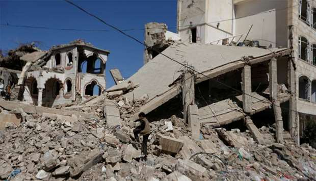 The wreckage of a building hit by air strikes in Sanaa