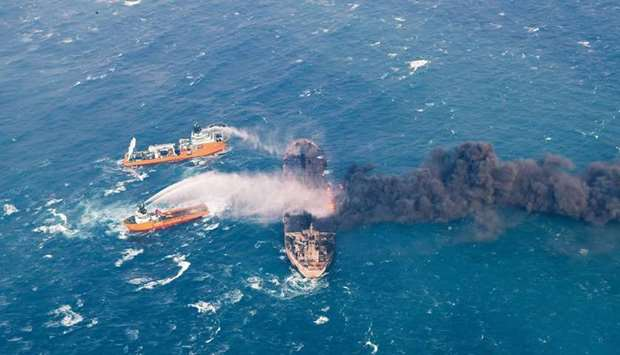 Rescue ships work to extinguish the fire on the Panama-registered Sanchi tanker