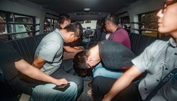 Suspects, part of a group of 17 detained over their part in an alleged oil theft at Shell's Pulau Bu