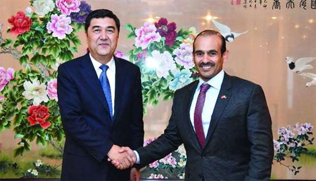 Al-Kaabi and Bekri shake hands during a high-level meeting held in China recently