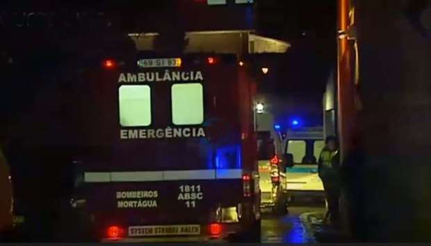 Ambulances and fire fighting vehicles arrive at the scene of fire