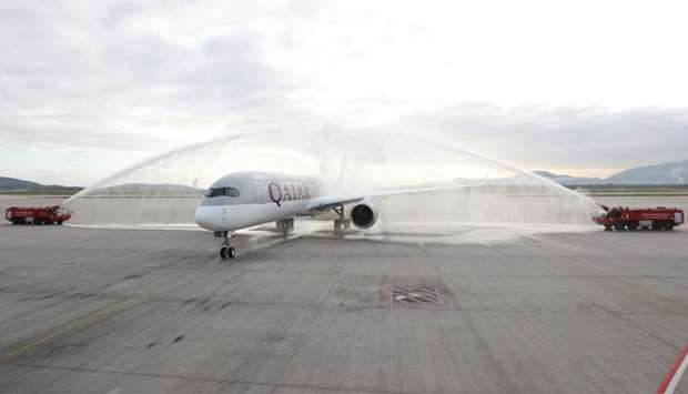 Qatar Airways' ultra-modern A350 receives a traditional water canon salute at Athens International A