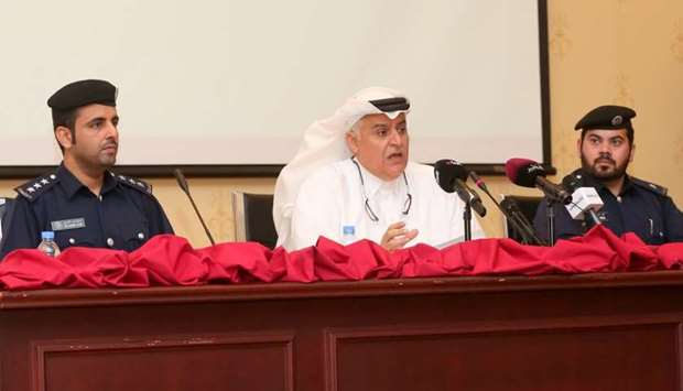 Brigadier Mohamed al-Malki (centre) announcing the achievements of the first 5-year Qatar Action Pla