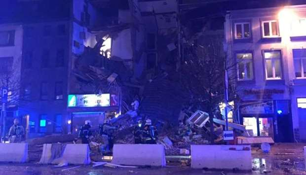 Emergency rescue personnel attend to the scene where a building has collapsed in Antwerp.