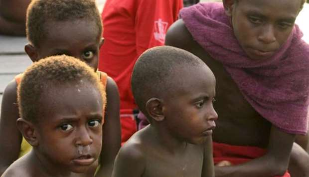 A group of Papuan children at their village home in Asmat