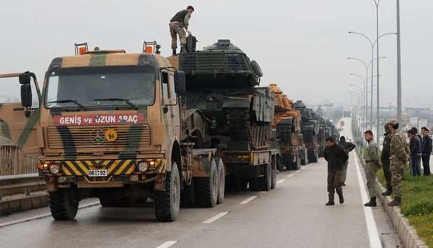 A Turkish convoy tank arrives at an army base in the border town of Reyhanli near the Turkish-Syrian