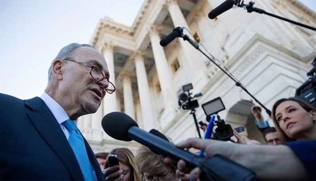 Senate Minority Leader Chuck Schumer speaks briefly with reporters