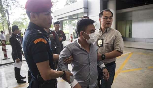 Boonchai Bach (C), an alleged Kingpin in Asia's illegal trade in endangered species