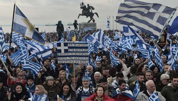 People holding flags of Greece take part in a demonstration to protest against the use of the name M