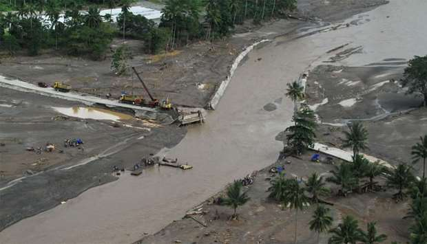 An aerial image shows damaged Daligdigan Bridge, washout and drifted some 600 meters from its origin