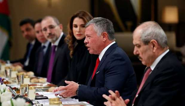 Jordan's King Abdullah and wife Queen Rania are seen during their meeting with US Vice President Mik
