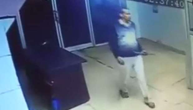 Image grab from a CCTV footage that shows Naresh Dhankar wielding an iron rod