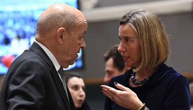France's Foreign Minister Jean-Yves Le Drian (L) and EU foreign policy chief Federica Mogherini spea