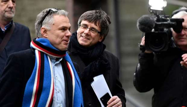Former Catalan leader Carles Puigdemont (C) arrives at the University of Copenhagen to take part in