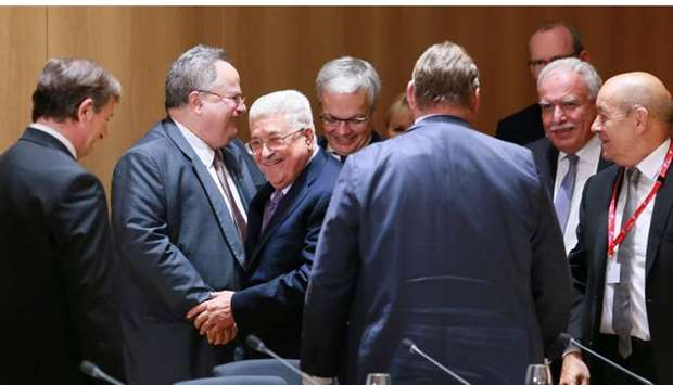 Palestinian President Mahmoud Abbas (C) attend a meeting with EU foreign ministers in Brussels, Belg