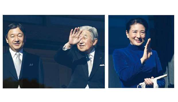 Japan's Emperor Akihito (right) and Crown Prince Naruhito wave to well-wishers during a public appea