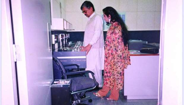 Qatar Urdu Radio hosts Saif-ur-Rehman and Farzana Safdar in the studio on March 29, 1993.