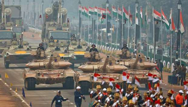 Indian soldiers in tanks take part in a full dress rehearsal for the Republic Day parade in New Delh