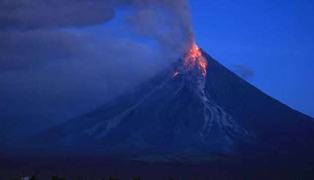 Lava spews from the Mayon volcano as it continues to erupt, seen from Legazpi City in Albay province