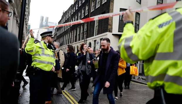 Workers are evacuated from offices on a street adjoining The Strand in central London