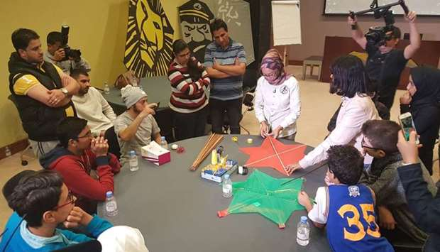 Renowned Singaporean trainer Gadis Widiyati Riyadi teaches participants basic kite-making at a works