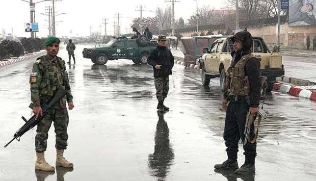 Afghan security forces stand near the Marshal Fahim military academy after a series of explosions in