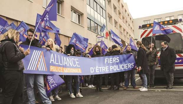 Members of the Alliance Police Nationale union gather yesterday for a protest outside the  Champign