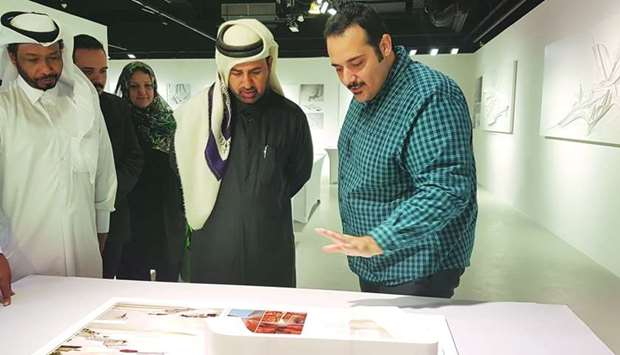 Mohamed Mohanad Barakat (right) briefs Dr Khalid Bin Ibrahim al-Sulaiti on his works during the open